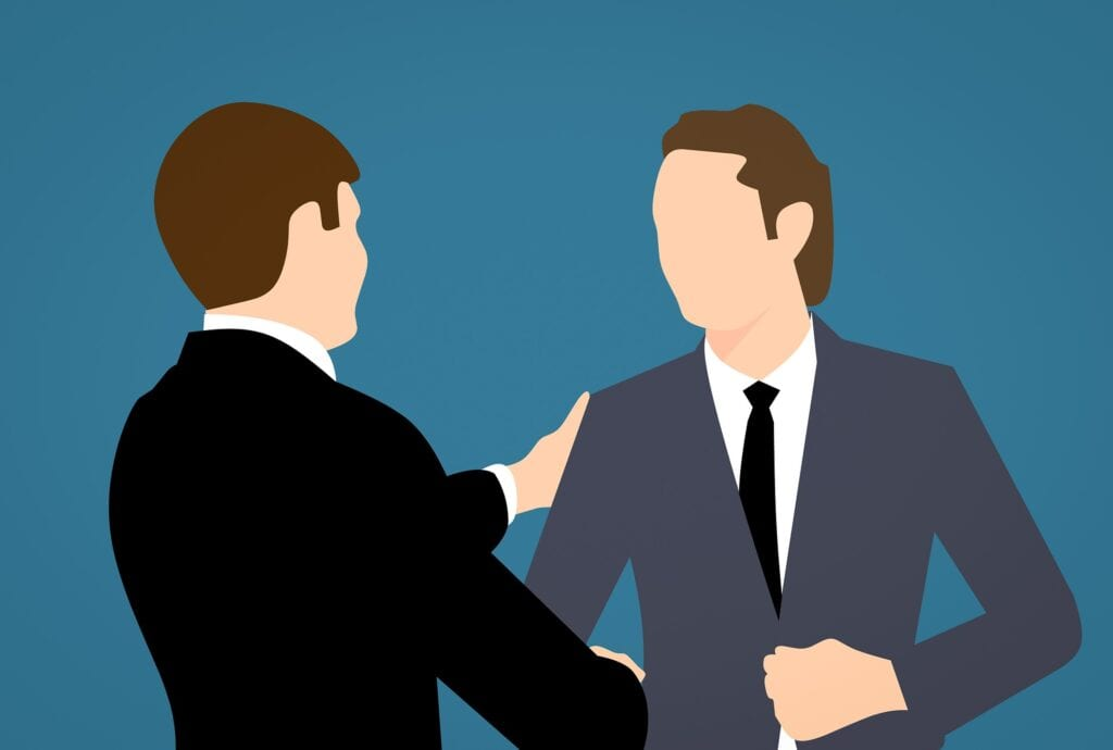 2 cartoon men in dark suits having a discussion, perhaps an interview.