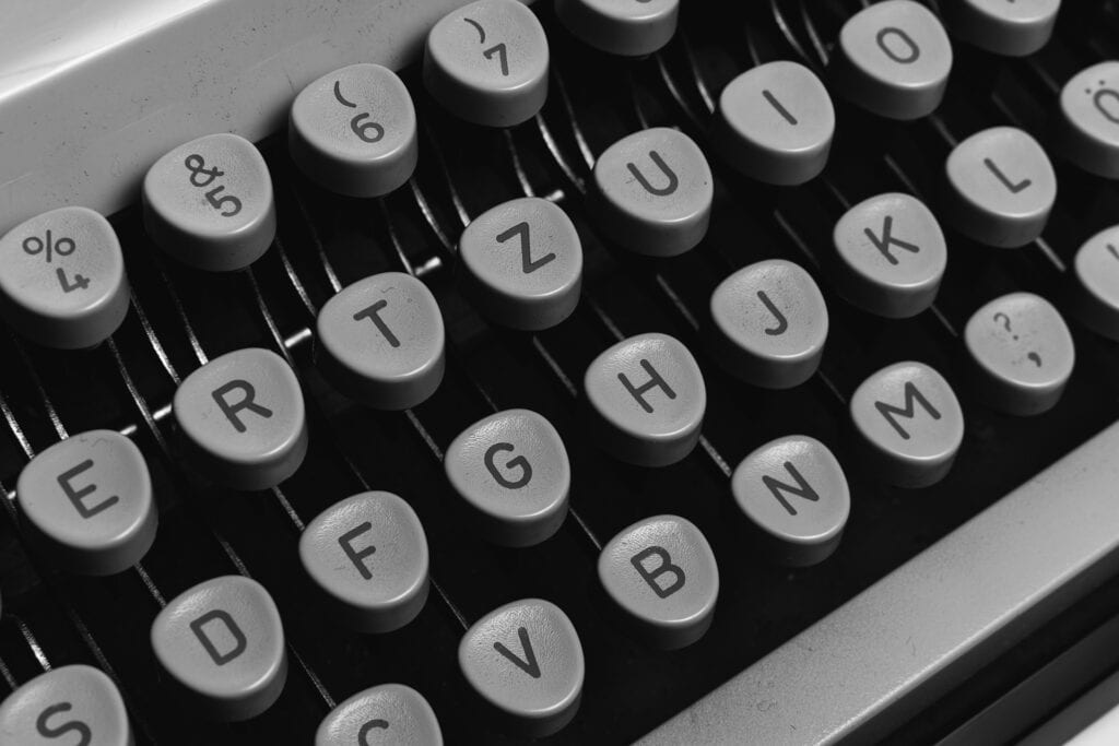 Black & white photo of part of a QWERTY keyboard.