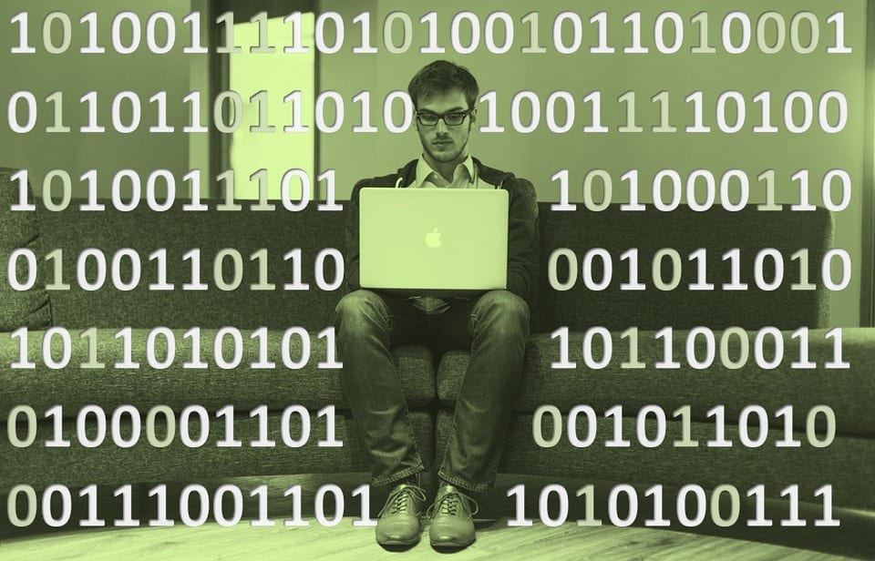Computer guy holding a yellow page with a background of binary numbers.